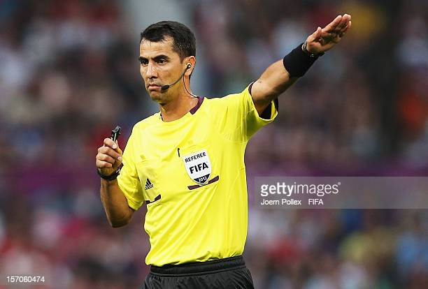 Referee Ravshan Irmatov gestures during the Men's Football first round Group A Match of the London 2012 Olympic Games between Great Britain and...