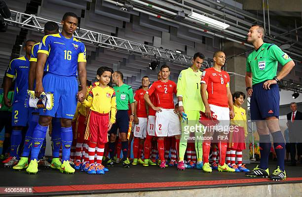 Referee Ravshan Irmatov looks on as Antonio Valencia of Ecuador prepares to lead the team out prior to the 2014 FIFA World Cup Brazil Group E match...