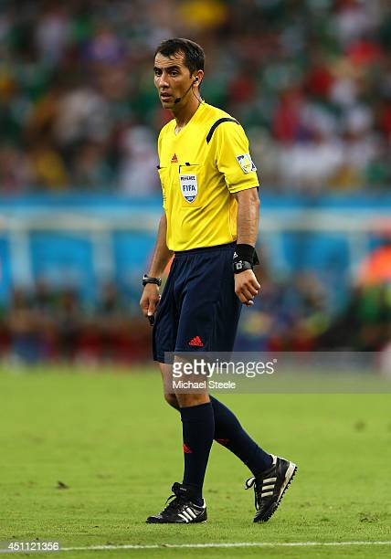 Referee Ravshan Irmatov looks on during the 2014 FIFA World Cup Brazil Group A match between Croatia and Mexico at Arena Pernambuco on June 23 2014...