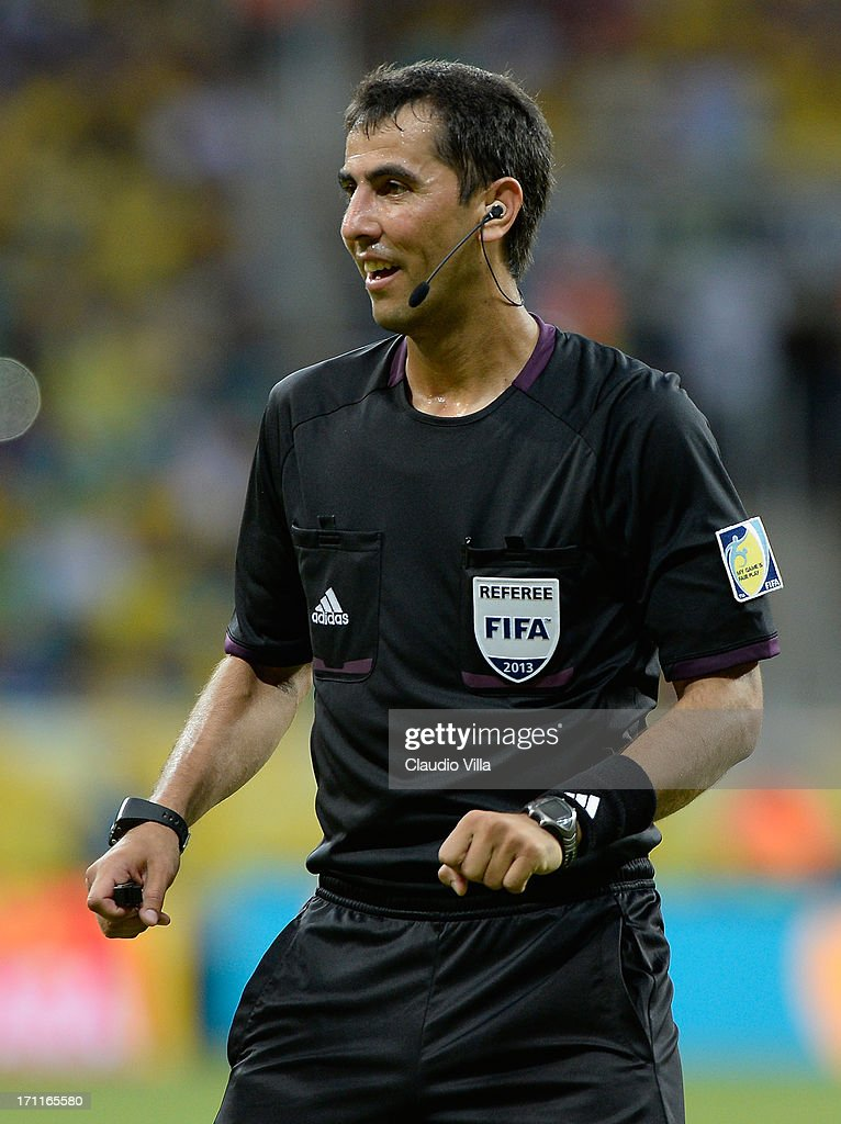Referee Ravshan Irmatov looks on during the FIFA Confederations Cup Brazil 2013 Group A match between Italy and Brazil at Estadio Octavio Mangabeira (Arena Fonte Nova Salvador) on June 22, 2013 in Salvador, Brazil.