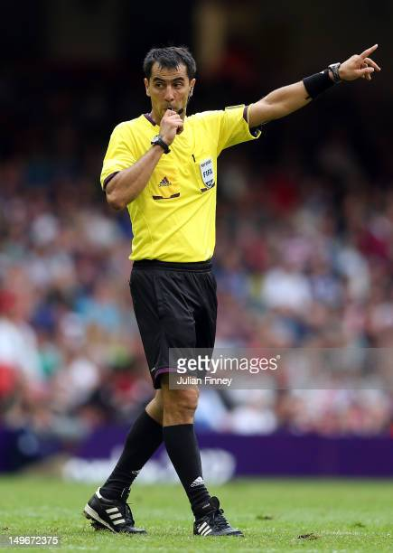 Referee Ravshan Irmatov of Uzbekistan gives a decision during the Men's Football first round Group B match between Mexico and Switzerland on Day 5 of...