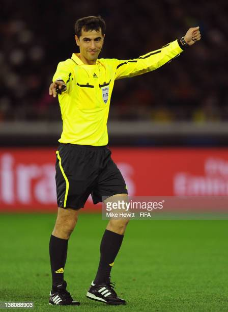 Referee Ravshan Irmatov of Uzbekistan in action during the FIFA Club World Cup Final match between Santos and FC Barcelona at the International...