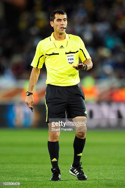 Referee Ravshan Irmatov officiates during the 2010 FIFA World Cup South Africa Group B match between Greece and Argentina at Peter Mokaba Stadium on...
