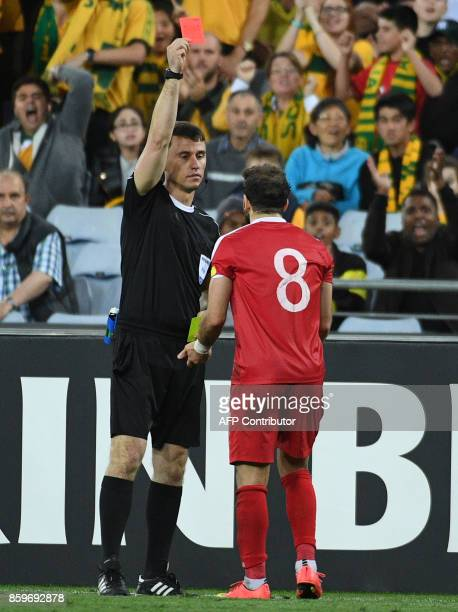 Referee Ravshan Irmatov shows a red card to Syria's Mahmoud Al Mawas during their 2018 World Cup football qualifying match in Sydney on October 10...