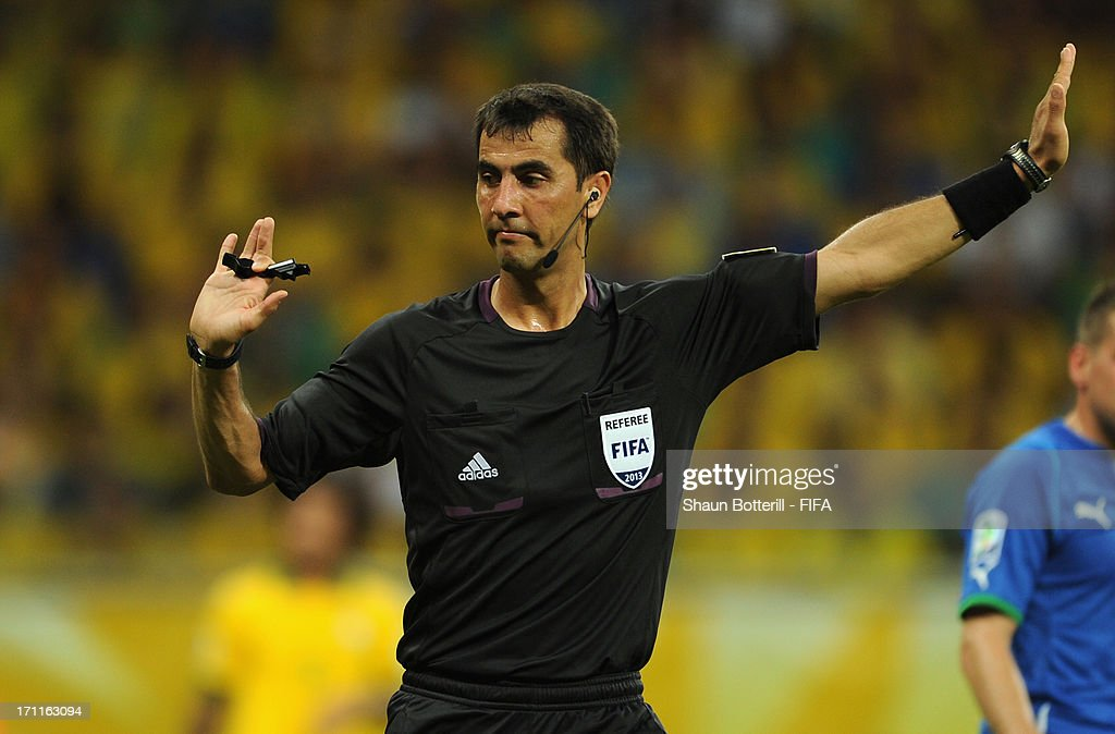 Referee Ravshan Irmatov signals during the FIFA Confederations Cup Brazil 2013 Group A match between Italy and Brazil at Estadio Octavio Mangabeira (Arena Fonte Nova Salvador) on June 22, 2013 in Salvador, Brazil.