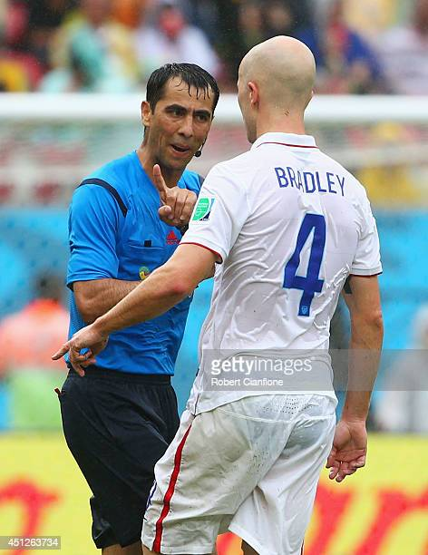 Referee Ravshan Irmatov speaks to Michael Bradley of the United States during the 2014 FIFA World Cup Brazil group G match between the United States...