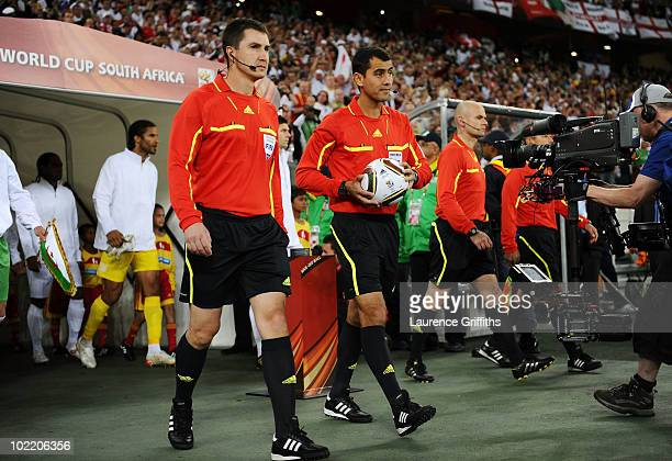 Referee Ravshan Irmatov with the official Jabulani matchball ahead of the 2010 FIFA World Cup South Africa Group C match between England and Algeria...