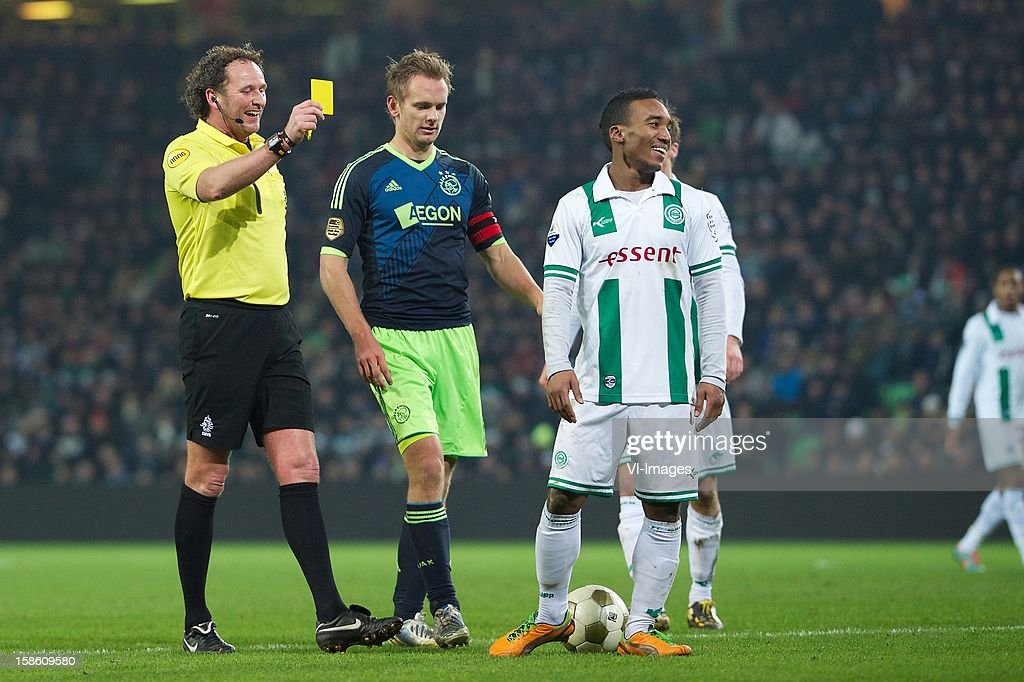 referee Reinold Wiedemeijer, Siem de Jong of Ajax, Lorenzo Burnet of FC Groningen during the Dutch Cup match between FC Groningen and Ajax Amsterdam at the Euroborg on December 20, 2012 in Groningen, The Netherlands.