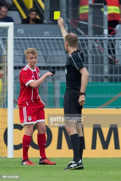Referee Rene Rohde show Felix Goetze of Munich a yellow card during the U19 German Championship Final match between U19 Borussia Dortmund and U19...