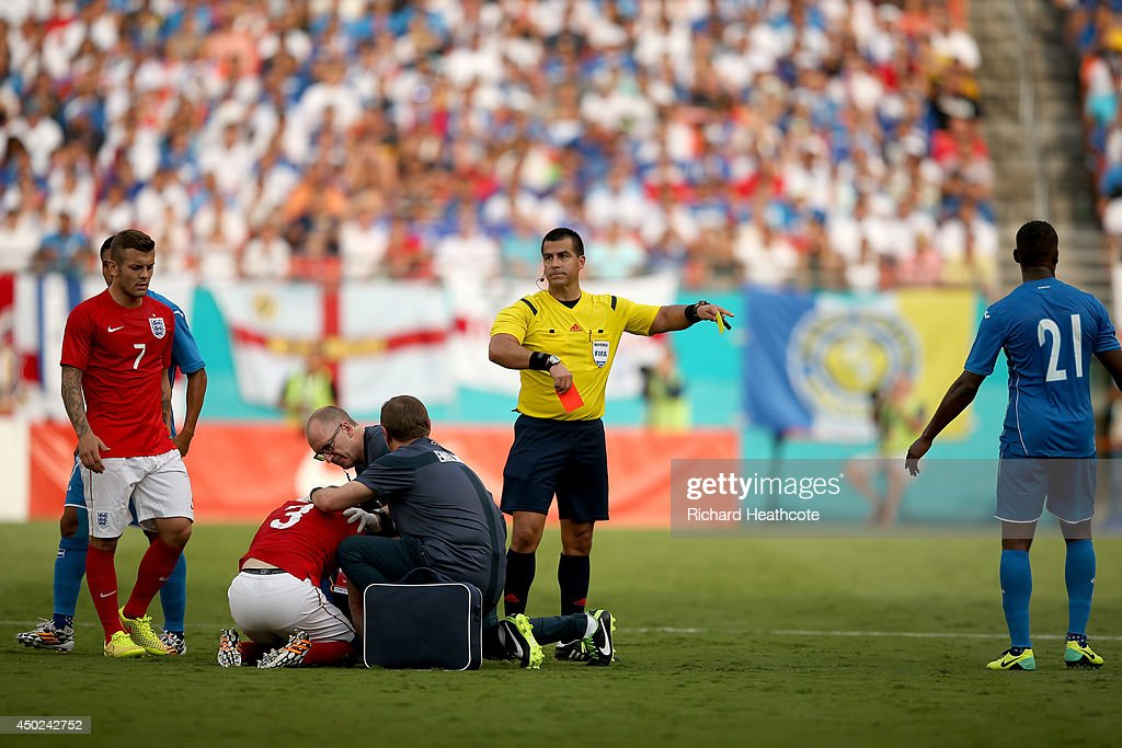 Referee Ricardo Salazar sends off Brayan Beckeles of Honduras for a challenge on Leighton Baines of England during the International Friendly match between England and Honduras at the Sun Life Stadium on June 7, 2014 in Miami Gardens, Florida.
