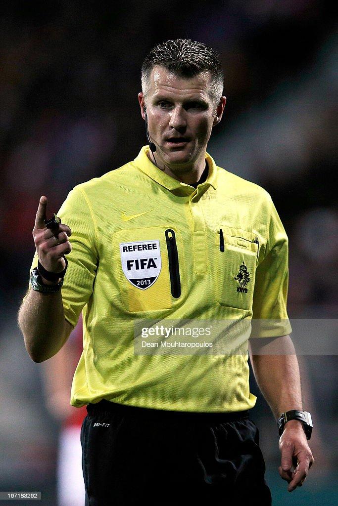 Referee, Richard Liesveld signals during the Eredivisie match between AZ Alkmaar and PSV Eindhoven at the AFAS Stadium on April 20, 2013 in Alkmaar, Netherlands.