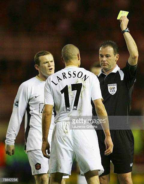 Referee Rob Styles shows Henrik Larsson of Manchester United a yellow card for diving during the FA Cup sponsored by EON Quarter Final match between...