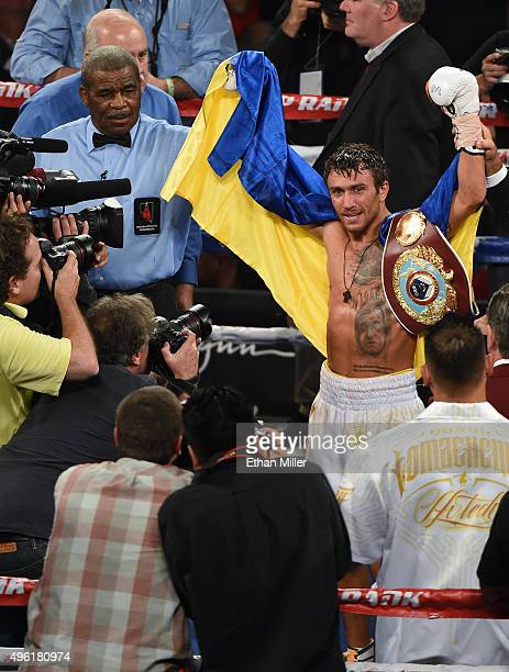 Referee Robert Byrd holds up Vasyl Lomachenko's arm after he retained his WBO featherweight title by knocking out Romulo Koasicha in the 10th round...