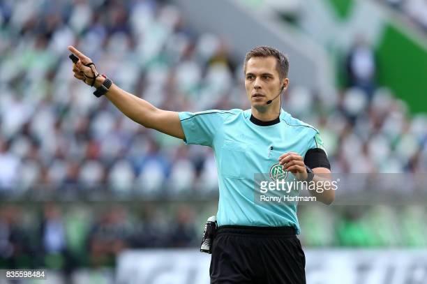 Referee Robert Hartmann gestures during the Bundesliga match between VfL Wolfsburg and Borussia Dortmund at Volkswagen Arena on August 19 2017 in...