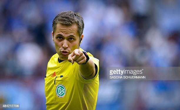 Referee Robert Hartmann reacts during the German first division Bundesliga football match Bayer 04 Leverkusen vs TSG 1899 Hoffenheim in Leverkusen...