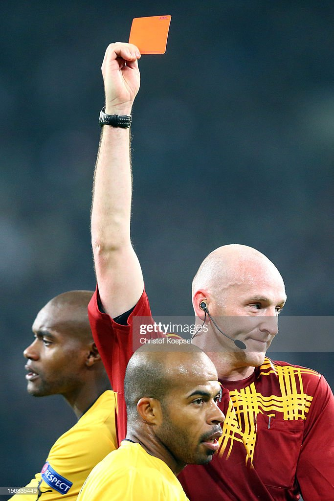 Referee Robert Madden of scotland shows Luciano Bebe of Limassol the red card during the UEFA Europa League group C match between Borussia Moenchengladbach and AEL Limassol FC at Borussia Park Stadium on November 22, 2012 in Moenchengladbach, Germany.