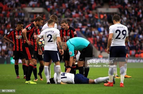 Referee Robert Madley checks on Tottenham Hotspur's GeorgesKevin Nkoudou during the Premier League match at Wembley Stadium London