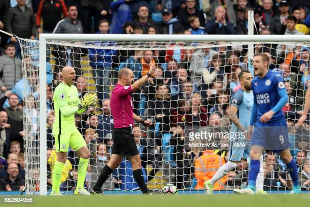Referee Robert Madley disallows the penalty kick of Riyad Mahrez of Leicester City after he struck the ball twice during the Premier League match...