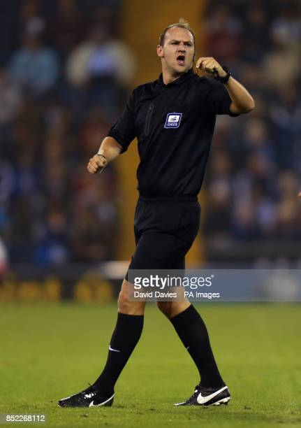 Referee Robert Madley during the Capital One Cup Third round match at The Hawthorns West Bromwich