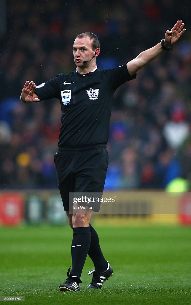 Referee Robert Madley gestures during the Barclays Premier League match between Crystal Palace and Watford at Selhurst Park on February 13, 2016 in London, England.