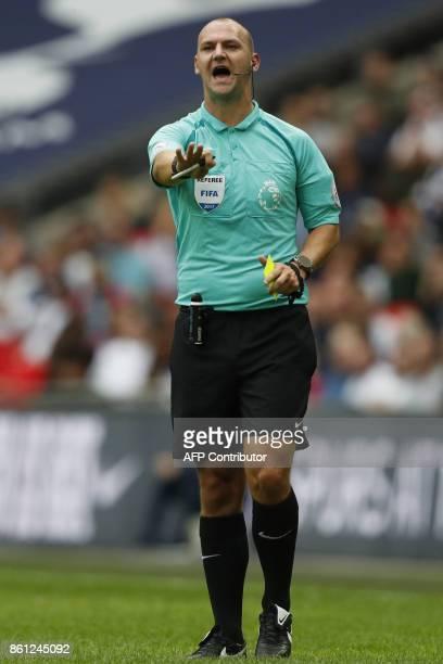 Referee Robert Madley gestures during the English Premier League football match between Tottenham Hotspur and Bournemouth at Wembley Stadium in...