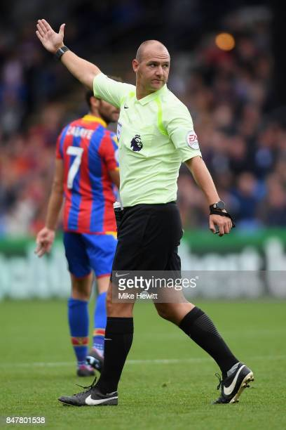 Referee Robert Madley gestures during the Premier League match between Crystal Palace and Southampton at Selhurst Park on September 16 2017 in London...