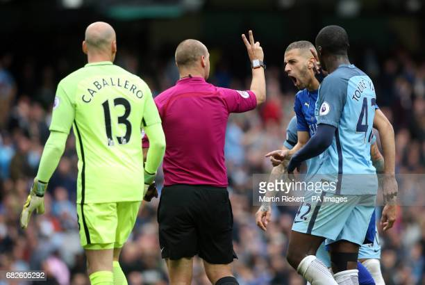 Referee Robert Madley gestures to Leicester City's Islam Slimani after disallowing Riyad Mahrez's goal from the penalty spot for a double hit during...