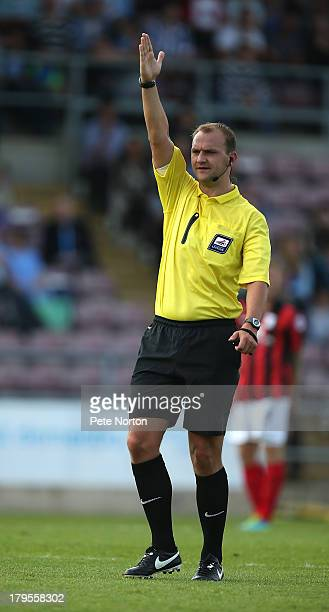Referee Robert Madley gives an indirect free kick during the Sky Bet League One match between Coventry City and Preston North End at Sixfields...