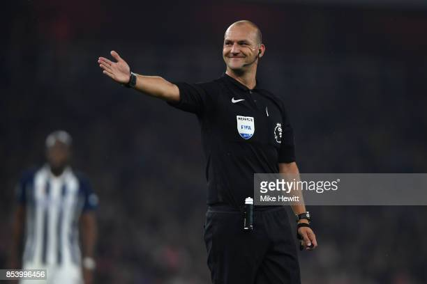 Referee Robert Madley in action during the Premier League match between Arsenal and West Bromwich Albion at Emirates Stadium on September 25 2017 in...