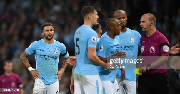 Referee Robert Madley issues a second yellow card to Manchester City player Kyle Walker and subsequent sending off during the Premier League match...