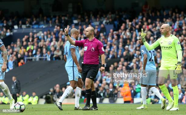 Referee Robert Madley rules out Riyad Mahrez of Leicester City's penalty after he slips and takes two touches during the Premier League match between...