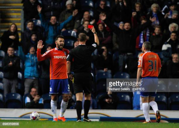 Referee Robert Madley shows Birmingham City's Neil Eardley the red card