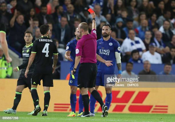 Referee Robert Madley shows the red card to Leicester City's Marcin Wasilewski