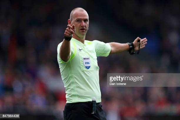 Referee Robert Madley signals during the Premier League match between Crystal Palace and Southampton at Selhurst Park on September 16 2017 in London...