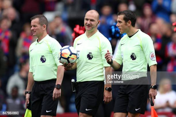 Referee Robert Madley walks out with his assistants Lee Betts and Marc Perry for the start of the Premier League match between Crystal Palace and...