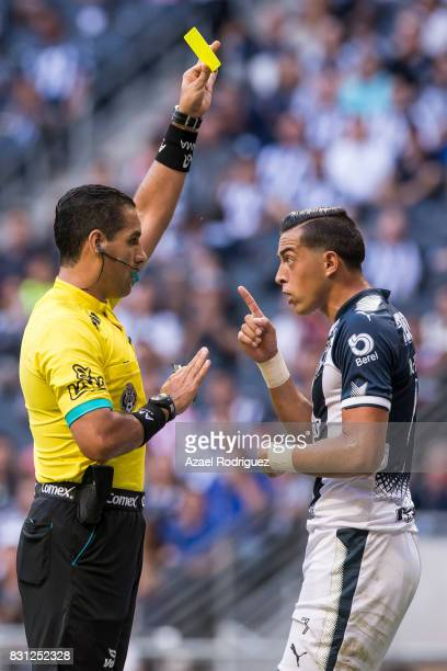 Referee Roberto Garcia gives a yellow card to Rogelio Funes Mori of Monterrey during the 4th round match between Monterrey and Chivas as part of the...
