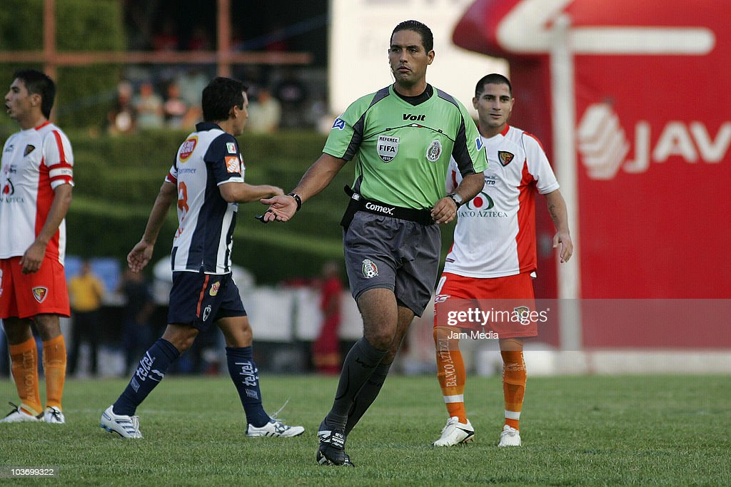Referee Roberto Garcia in action during a match between Monterrey and Jaguares as part of the Apertura 2010 at Tecnologico Stadium on August 28, 2010 in Monterrey, Mexico.