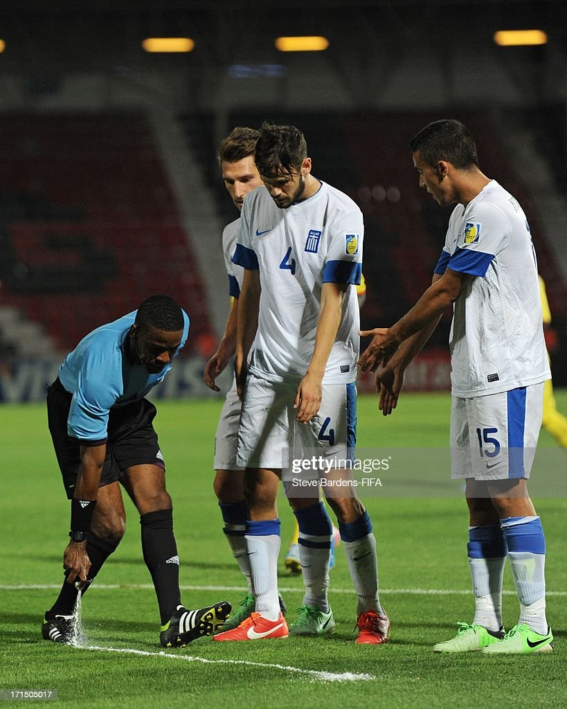Referee Roberto Moreno of Panama sprays a foam marker line onto the pitch to illustrate where the Greek defensive wall must stand during the FIFA U20 World Cup Group D match between Mali and Greece at Kamil Ocak Stadium on June 25, 2013 in Gaziantep, Turkey.