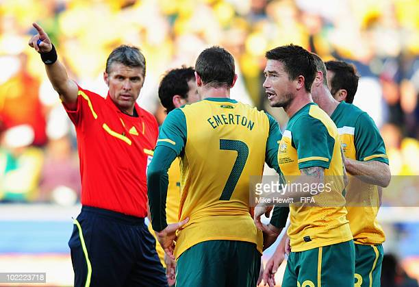 Referee Roberto Rosetti asks Harry Kewell of Australia to leave the pitch after showing him a red card for handling the ball on the line during the...