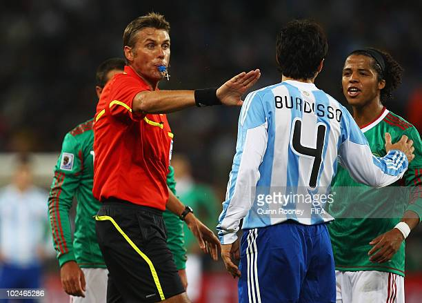 Referee Roberto Rosetti gestures during the 2010 FIFA World Cup South Africa Round of Sixteen match between Argentina and Mexico at Soccer City...