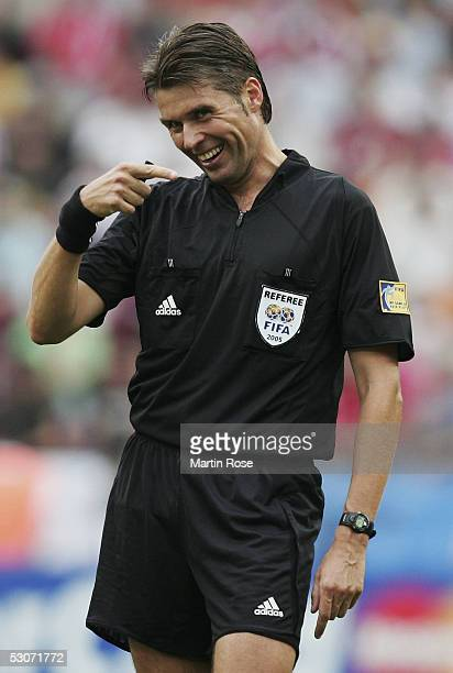 Referee Roberto Rosetti of Italy gestures during the FIFA Confederations Cup Match between Argentina and Tunisia on June 15 2005 in Cologne Germany