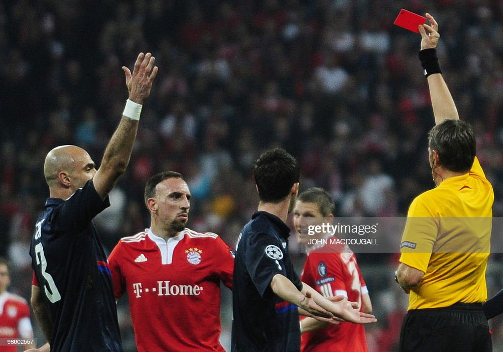 Referee Roberto Rosetti of italy shows a red card to Bayern Munich's French midfielder Franck Ribery during the first leg UEFA Champions League semi-final football match FC Bayern Munich vs Olympique Lyonnais at the Allianz Arena in the southern German city of Munich on April 21, 2010.