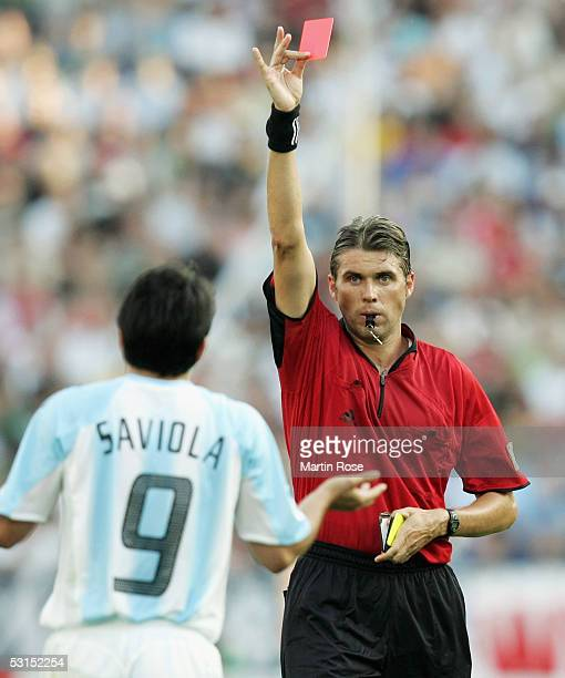 Referee Roberto Rosetti of Italy shows Javier Saviola the red card during the FIFA Confederations Cup 2005 Semi Final match between Mexico and...