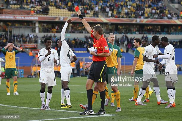 Referee Roberto Rosetti sends off Harry Kewell for handball and awards Ghana a penalty during the 2010 FIFA World Cup South Africa Group D match...