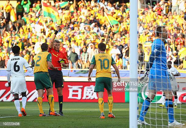 Referee Roberto Rosetti shows Harry Kewell of Australia a red card for handling the ball on the line during the 2010 FIFA World Cup South Africa...