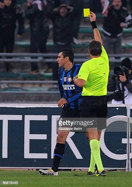 Referee Roberto Rosetti shows the yellow card to Lucio of Inter during the Serie A match between Bari and Inter Milan at Stadio San Nicola on January...