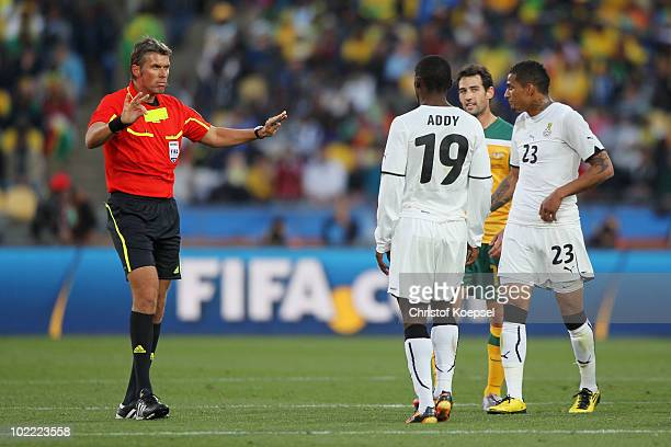 Referee Roberto Rosetti tells Lee Addy and Kevin Prince Boateng of Ghana to calm down during the 2010 FIFA World Cup South Africa Group D match...
