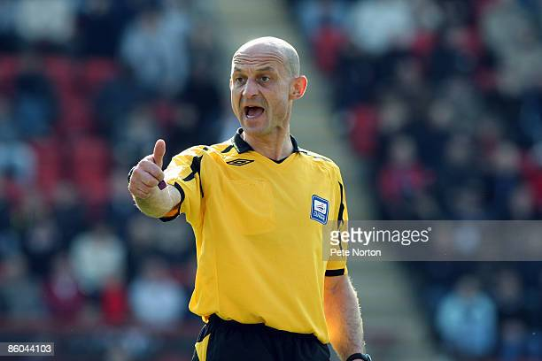 Referee Roger East in action during the Coca Cola League One Match between Leyton Orient and Northampton Town at The Matchroom Stadium on April 18...