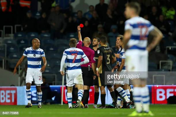 Referee Roger East shows a red card to Lee Gregory of Millwall during the Sky Bet Championship match between Queens Park Rangers and Millwall at...