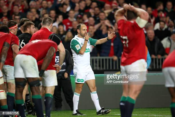 Referee Romain Poite blows the whistle to end the game during the third rugby union Test match between the British and Irish Lions and New Zealand...